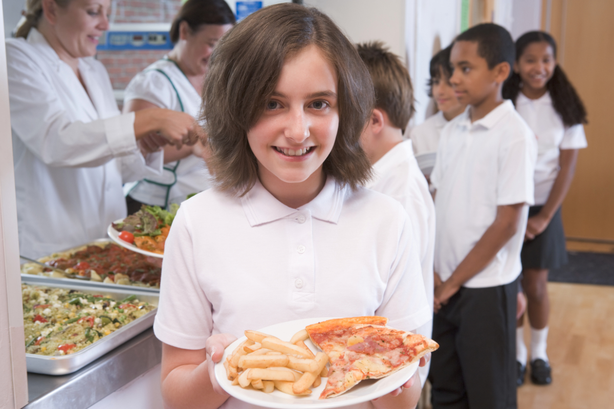 Girl with pizza and fries for school lunch