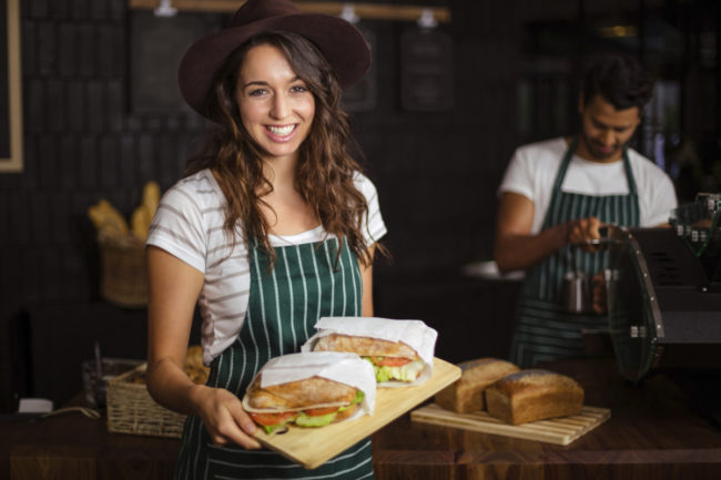 Barista with sandwiches