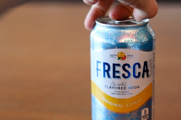 Opening can of Fresca, Coca-Cola