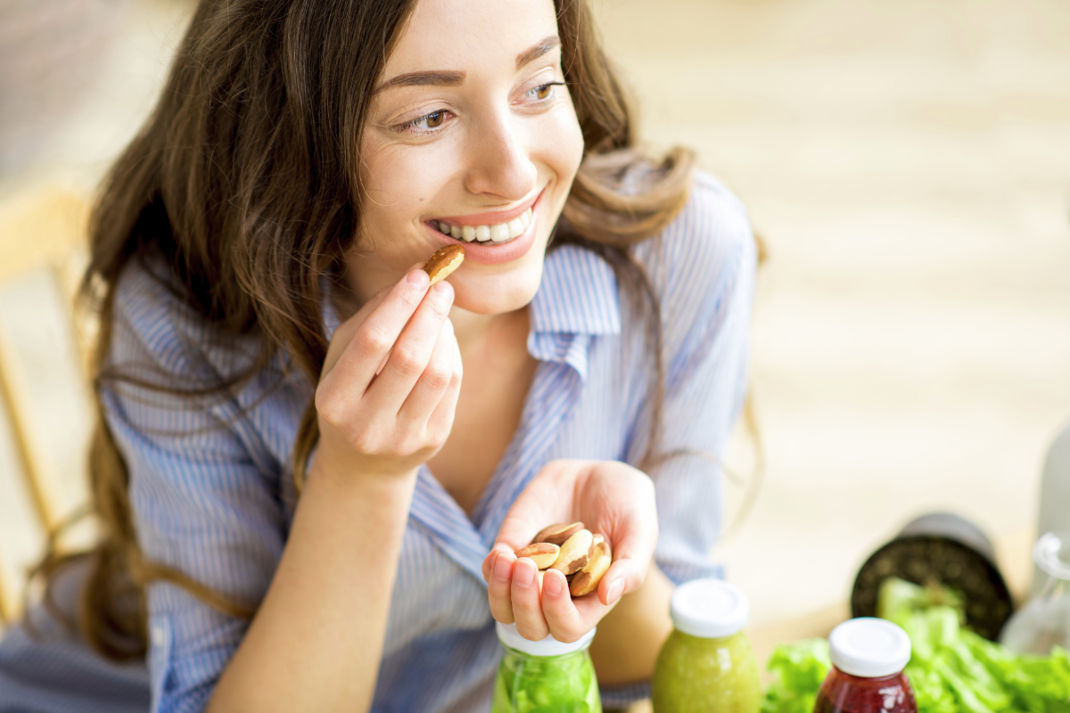 Woman snacking on Brazil nuts