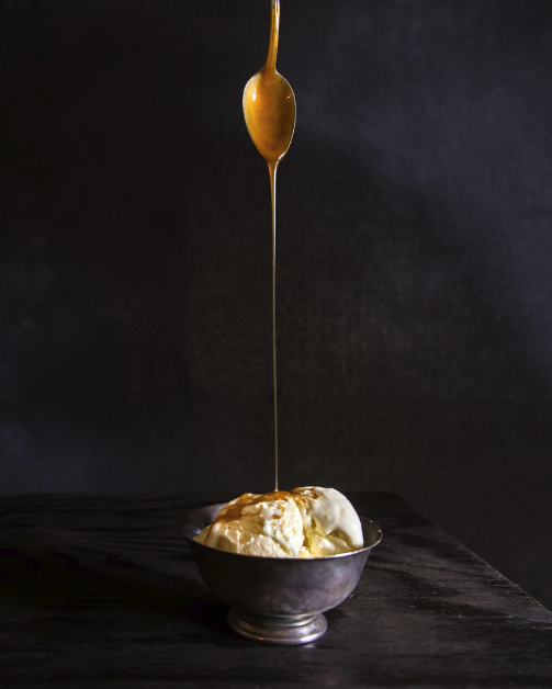 Drizzling caramel on ice cream