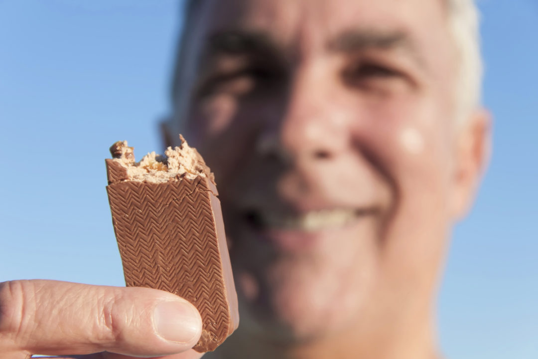 Baby Boomer eating chocolate candy