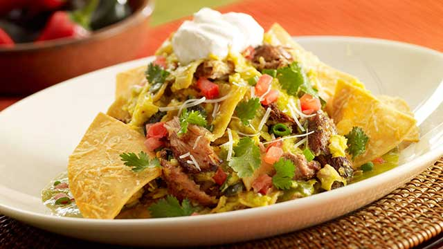The Cheesecake Factory Green Chilaquiles With Carnitas And Eggs