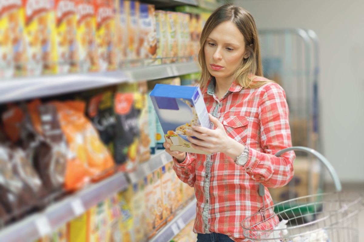 Woman reading a confusing food label