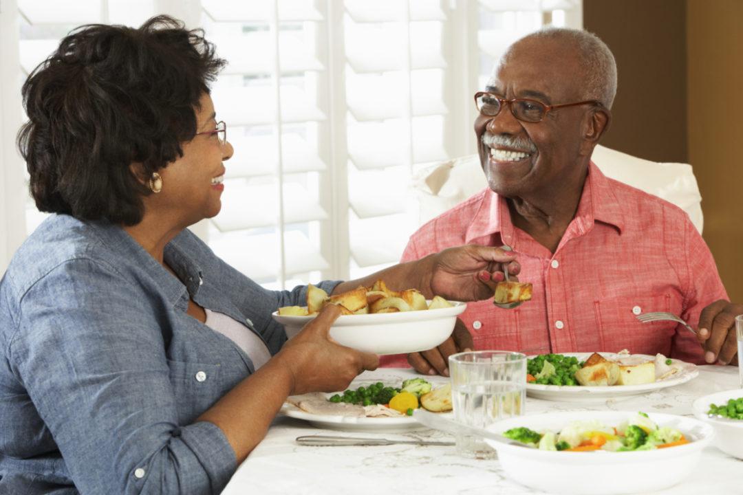 Senior couple eating dinner