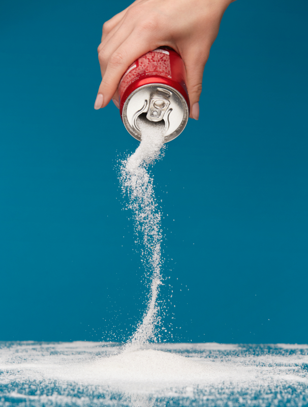 Pouring sugar out of a soda can