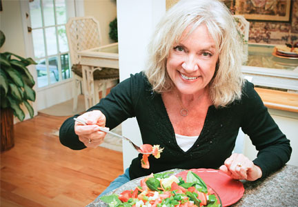Older woman classified as Baby Boomer eating a salad