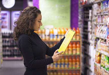 Woman checking ingredients label