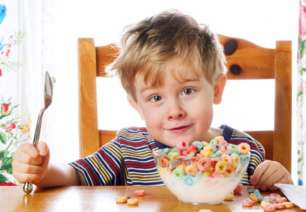 Child eating bowl of sugary cereal