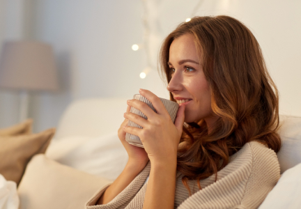 Woman drinking chamomile tea before bed
