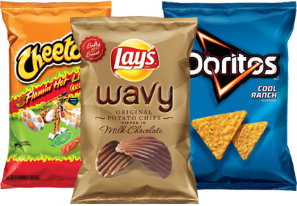 3 bags of chips, including lays and doritoes and cheetos