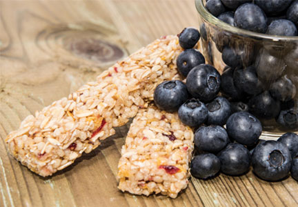 Gluten-free granola bars and fresh blueberries