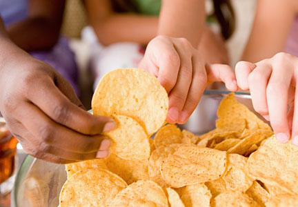 Millennials snacking on chips