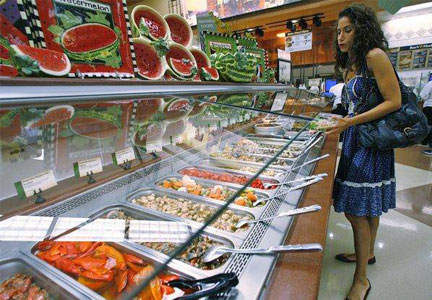 Woman choosing food at grocerant