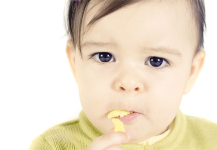 Infant eating peanut