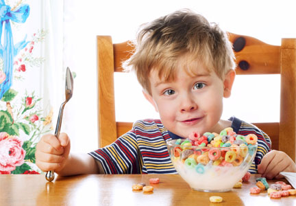 Young boy eating colorful cereal