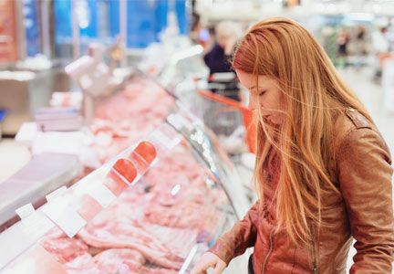 Woman in meat department