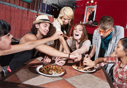 Young people eating at a restaurant, millennials
