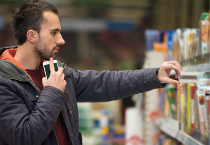 Millennial man grocery shopping with smartphone