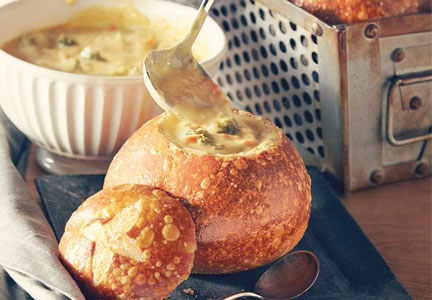 Panera Bread broccoli cheddar soup in a bread bowl