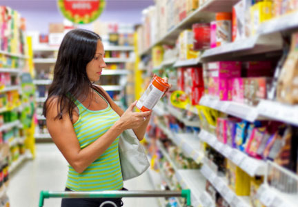 Young millennial woman reading nutrition label on food