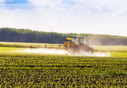 Farmer spraying neonicotinoids on crops